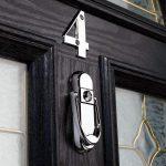 affinity-chrome-door-knocker-on-black-door_b166528c-f0d2-4f6e-8b1e-fc1817bb167a-1.jpg
